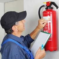 a fire extinguisher being examined